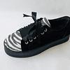 Zapatilla cuero reno negra y cebra