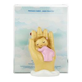 Anjo protetor bebé na mão