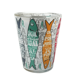 Shot glass with colored sardines