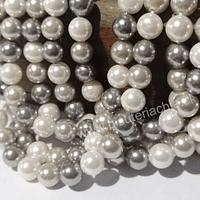 Perla Shell 6 mm, en colores blancos y grises, tira de 64 perlas aprox