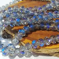 Cristal gris tornasol con brillo azules de 8mm por 6mm, tira de 69 unidades aprox