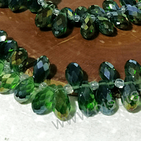 cristal en forma de gota, facetado color verde tornasol, 12 mm de largo por 6 mm de ancho, set de 10 unidades