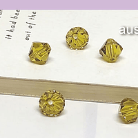 Cristal Austriaco tupi de 6 mm, color amarillo verdoso, set de 5 unidades