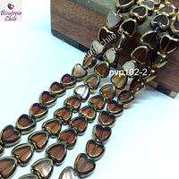 Vidrio en color café con aplicaciones de cobre en forma de cobre, 10 mm de diámetro por 10 mm de ancho, tira de 30 perlas aprox.
