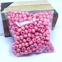 Cuenta de madera color rosado 6 mm, bolsa de 25 grs.