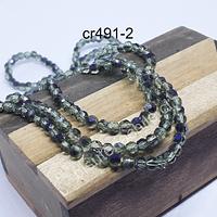 Cristal redondo facetado de 4 mm, en tono verde claro tornasol, con tonos morados, tira de  105 cristales