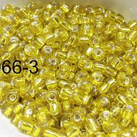 Mostacillon color amarillo cristal, bolsa de 50 grs. (6/0)