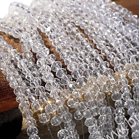 Cristal facetado transparente tornasol de 2 x 2 mm, tira de 190 cristales