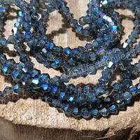 Cristal tupi 4 mm en color gris con tonalidades azules, tira de 75 cristales aprox.