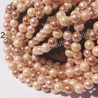 Perla Shell 6 mm, en colores rosados cobrizos, tira de 64 perlas aprox