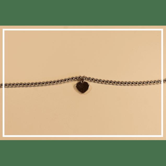 Pulsera plata con corazon dorado