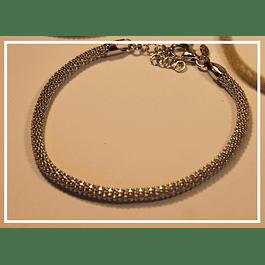 Pulsera de plata tejida con bano de oro blanco
