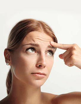 Elimina las arrugas de la frente, entrecejo y patitas de gallo con Toxina botulínica
