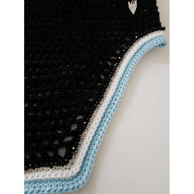 Black square with black crystals, white and blue trim