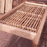 Panel rígido con anillos enmarcado en madera