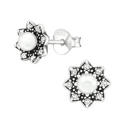 Aritos perlas + circones.
