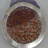 Círculo tejido de cobre y plata