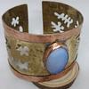 Brazalete calado bronce y cobre
