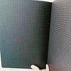 Cuaderno hojas negras y puntos blancos