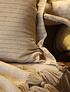 Cojín fusión lino pompón beige