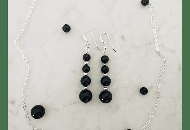 Aros de piedras ónix y detalles de plata