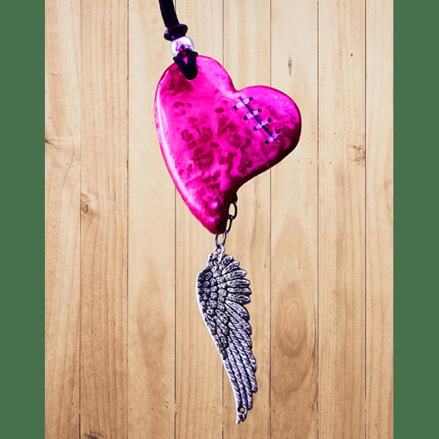 Dije de corazón con alas