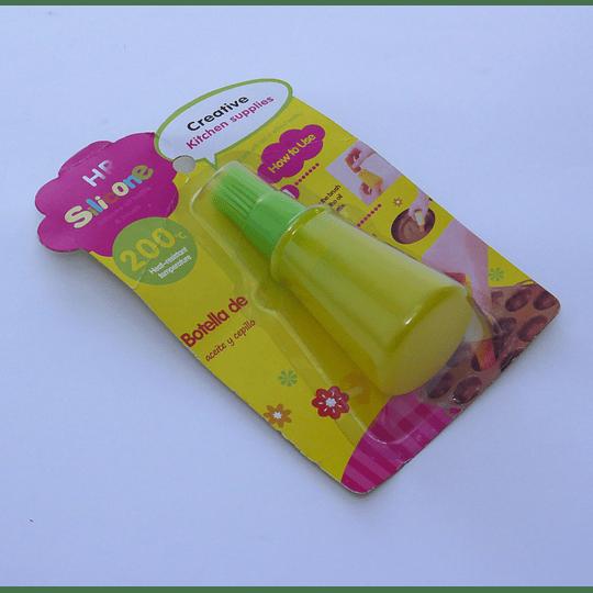 Botella de  Aceite y Cepillo Silicona S amarillo