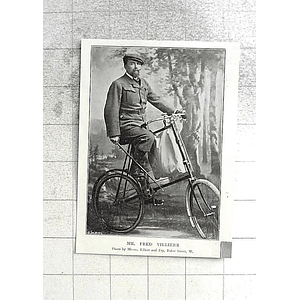 1897 Mr Fred Villiers On His Bike With Cane