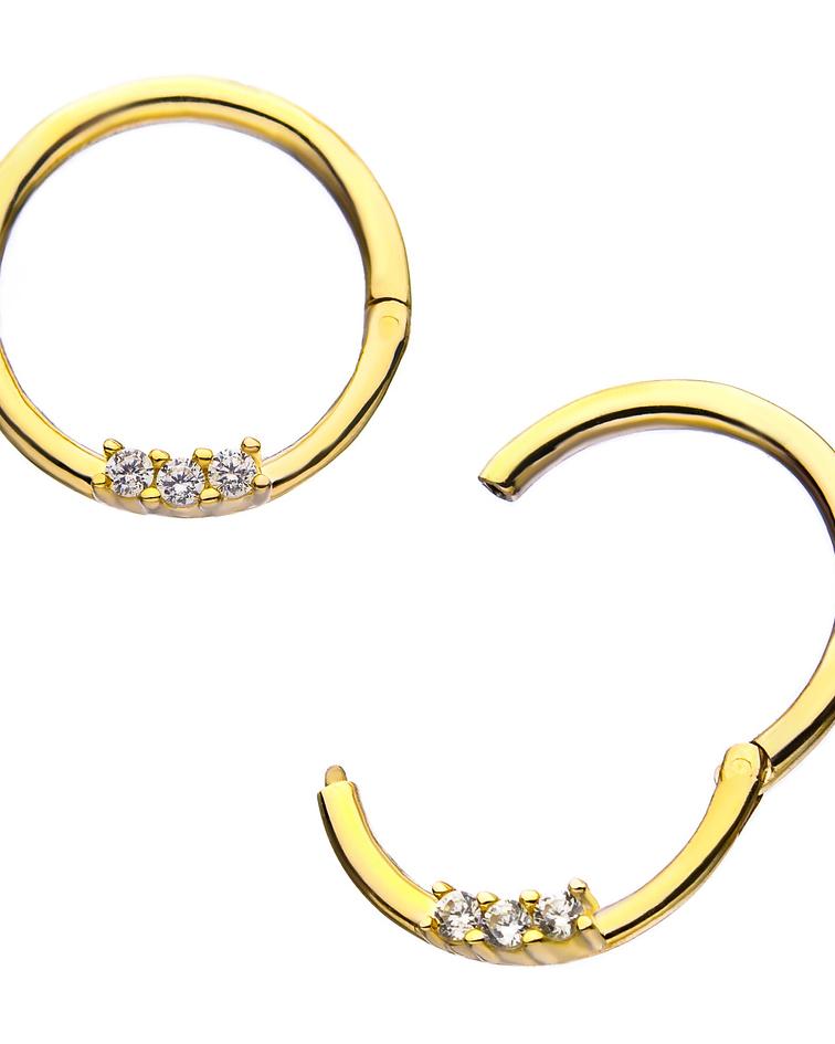 Clicker con triple zirconia cristal prong set en oro amarillo
