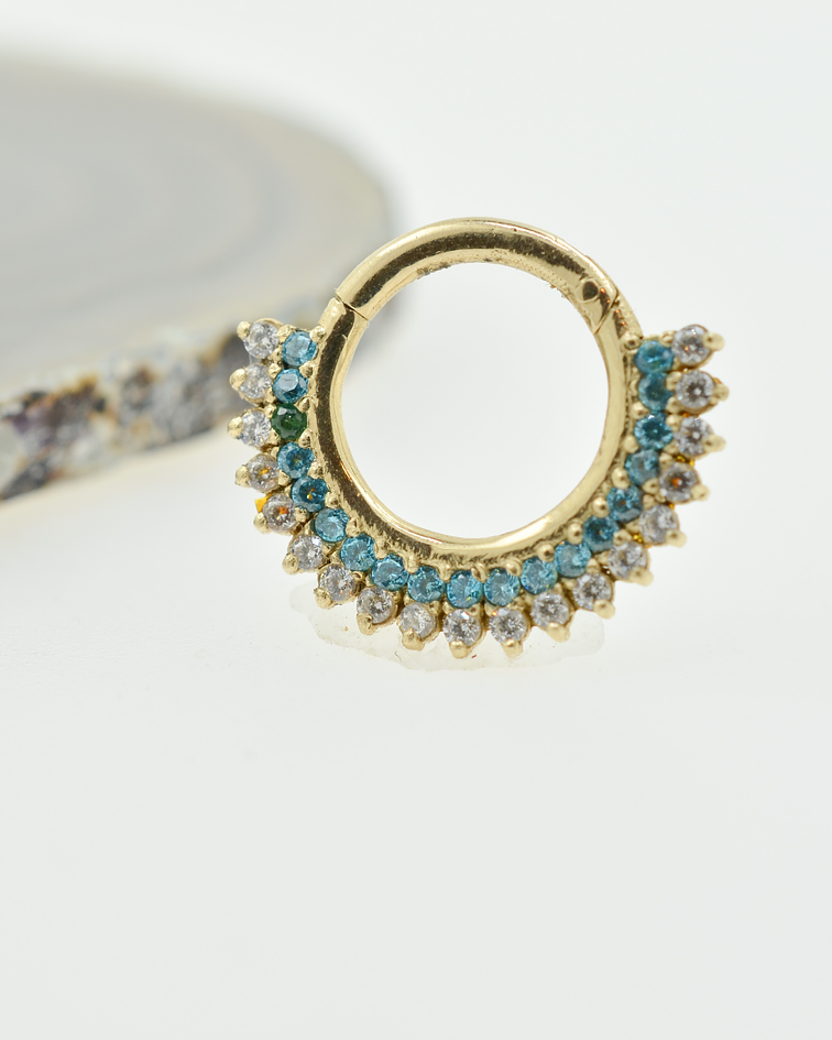 Clicker con zirconia cristal y aquamarine en oro amarillo
