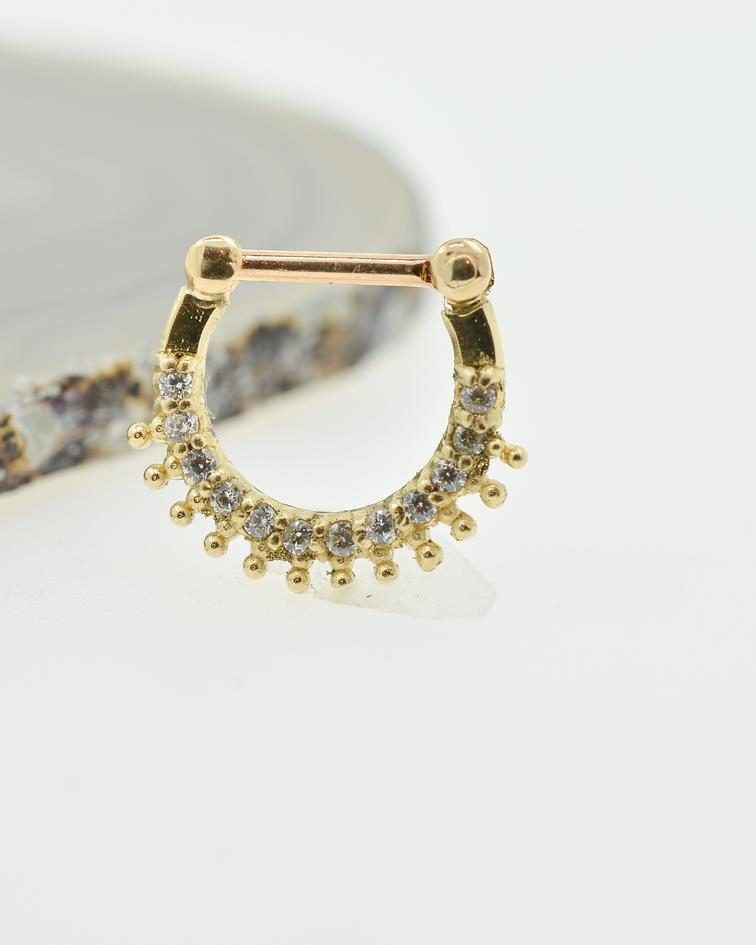 Clicker con zirconias cristal y bolitas en oro amarillo