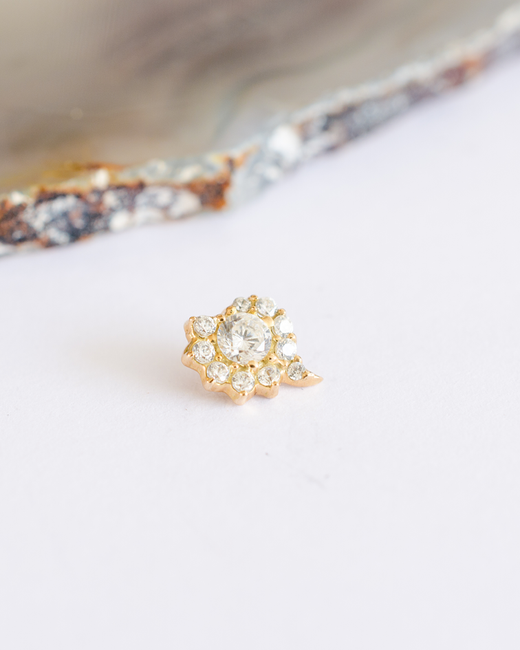 Caracola con gemas en oro amarillo - 14g