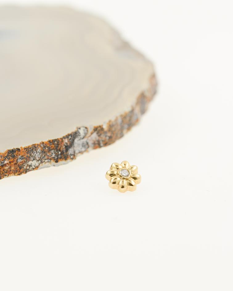Flor con gema en oro amarillo - 14g
