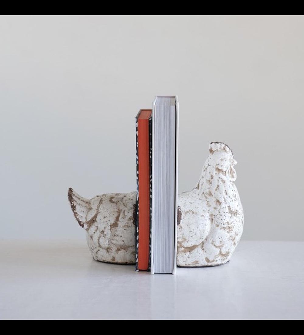 Gallina sujeta libros