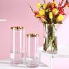 Floreros vidrio circulares dorados