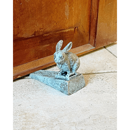 Sujeta puerta conejo fierro