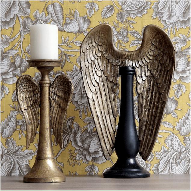 Alas doradas pedestal