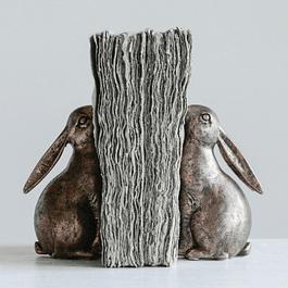 Conejos sujeta libros