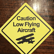CARTEL CAUTION LOW FLYING AIRCRAFT