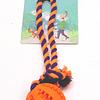 Juguete. Pelota para colocar premios con cuerda para perro.