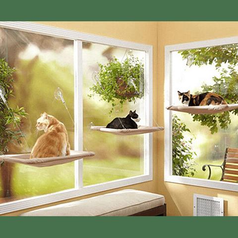 Cama colgante de ventana para gatos.