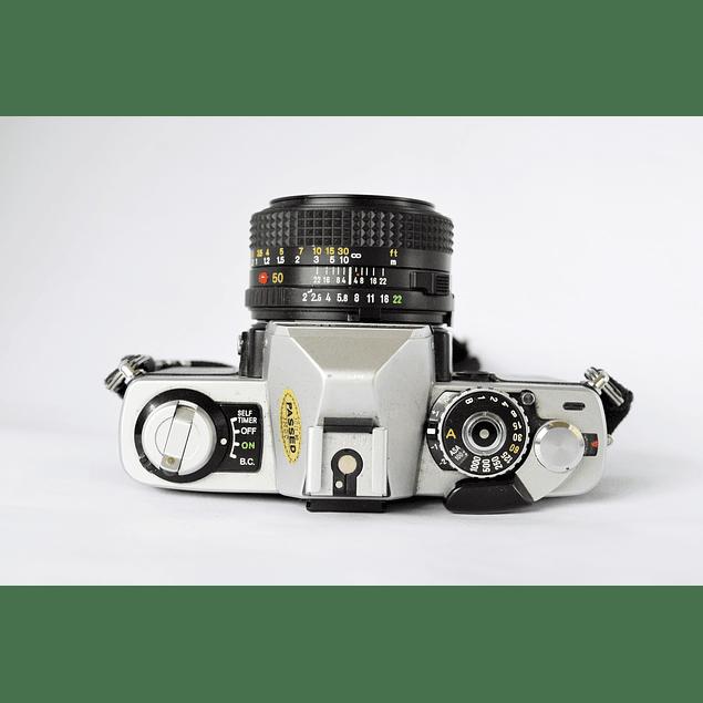 CÁMARA ANALÓGICA REFLEX MINOLTA XG1 + LENTE MINOLTA MD 50mm f2