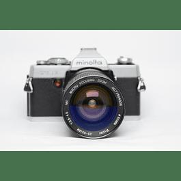 CÁMARA REFLEX ANÁLOGA MINOLTA XG-1 + LENTE ZOOM 28-55 mm f3.5-4.5