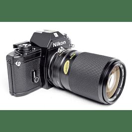 CÁMARA FOTOGRÁFICA REFLEX ANALÓGICA 35mm NIKON EM  + LENTE VIVITAR 35-105mm f3.2