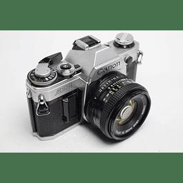 CÁMARA REFLEX ANÁLOGA CANON AE-1 + LENTE CANON 50mm f1.8