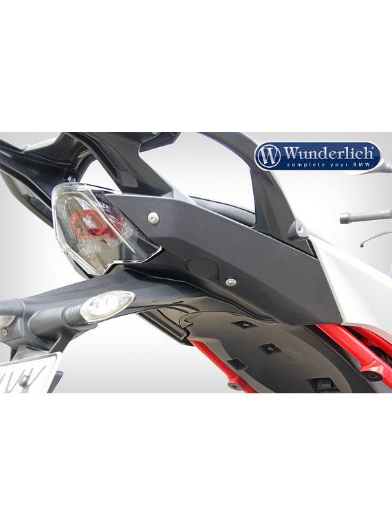 Tail fairing cover plugs