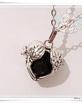 Llamador Corazón alado con piedra volcánica