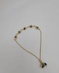 Manilla de ojitos azules ajustable a la mano 14k 5 pulgadas 5.7g