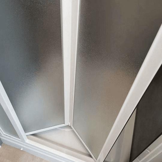 Puerta plegable con marco para cabina de baño